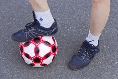 Feet athletes-women with a soccer ball Royalty Free Stock Image
