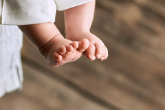 Feet of baby close up. Childish legs on blurred background. Things to know about newborns Stock Photos