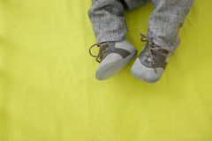 Feet of baby shoes to leather gray Royalty Free Stock Image
