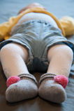 Feet of Baby sleeping. Feet of Baby with onesie lying supine sleeping Stock Photography
