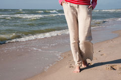 Feet on the background of the sea Stock Image