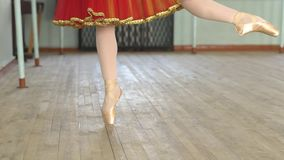 Feet of ballerina EN Pointe. En pointe- A ballet dancer in her ballet pointe shoes stock video