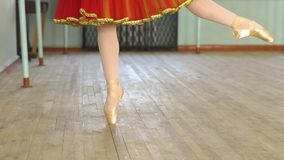 Feet of ballerina EN Pointe. En pointe- A ballet dancer in her ballet pointe shoes stock footage