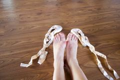 Feet of ballet dancer tired took off her shoes royalty free stock photography