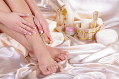 Feet with bathroom accessory Royalty Free Stock Image