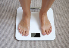 Feet on bathroom scale Royalty Free Stock Photos