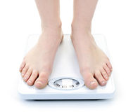 Feet on bathroom scale Stock Photos