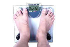 Feet on a bathroom scale Stock Photography