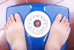Feet on a bathroom scale Royalty Free Stock Images