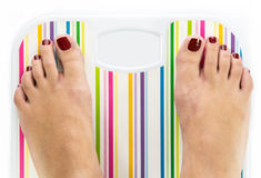 Feet on bathroom scale with blank dial copy-space. Isolated Stock Image