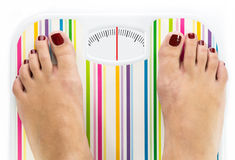 Feet on bathroom scale with clean dial. With lines no numbers Stock Image