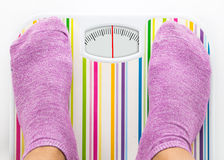 Feet on bathroom scale with clean dial Royalty Free Stock Photo
