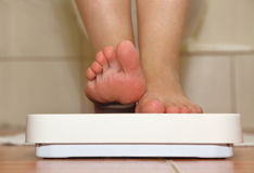 Feet on bathroom scale Stock Images