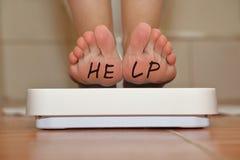 Feet on bathroom scale Stock Photos