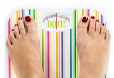 Feet on bathroom scale. With words Do it on dial Stock Images