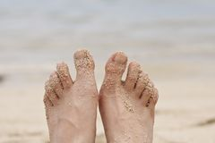Feet on a beach Stock Images