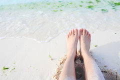 Feet beside the beach Royalty Free Stock Photography