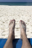 Feet on Beach. Two feet relaxing on a beach by the ocean Stock Photo
