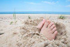 Feet on beach stock photos