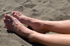 Feet on beach Stock Image