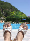 Feet with beach shoes Stock Image