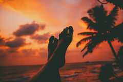 Feet on beach. Silhouette of feet at sunset beach stock images