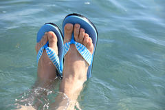 Feet in beach slippers Royalty Free Stock Photos