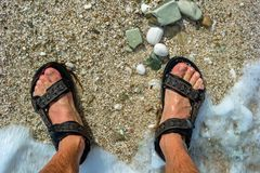 Feet on the beach in the waves. Albania royalty free stock images