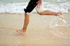 Feet on the beautiful  beach Stock Photo