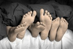 Feet in Bed Royalty Free Stock Photos