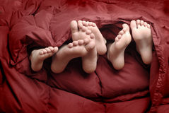 Feet in Bed Stock Photos