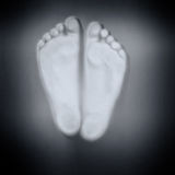 Feet behind glass Stock Photography