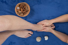 Feet being massaged by female masseuse Royalty Free Stock Images