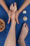 Feet being massaged by female therapist Royalty Free Stock Photo