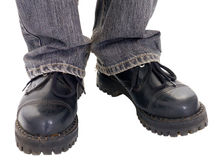 Feet in the big black boots Stock Photography