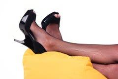 Feet in black heels. Stock Images