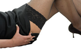 Feet in black mesh stockings Royalty Free Stock Photo