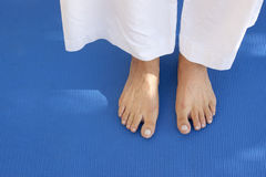 Feet on a blue mat Royalty Free Stock Photo