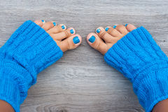 Feet with blue nails manicure Stock Image