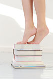 Feet on books Royalty Free Stock Photography