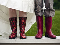 Feet with boots. Newly-married couple with rubber boots royalty free stock photography