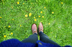 Feet in boots on grass background Royalty Free Stock Photo
