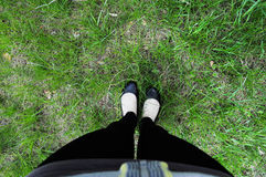 Feet in boots on grass background Royalty Free Stock Photography