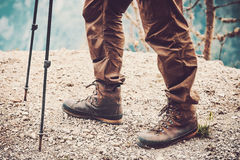 Feet boots hiking at mountains Travel Lifestyle. Adventure summer vacations outdoor concept Stock Images