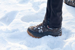 Feet in boots on the snow. Royalty Free Stock Photos