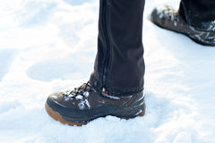 Feet in boots on the snow. Royalty Free Stock Photo