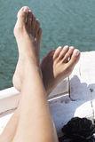 Feet on Bow of Boat Royalty Free Stock Photo
