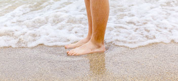 Feet of boy at the beach Stock Photo