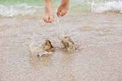 Feet of boy jumping into the water Stock Photography