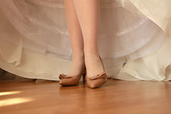 The feet of the bride Royalty Free Stock Image